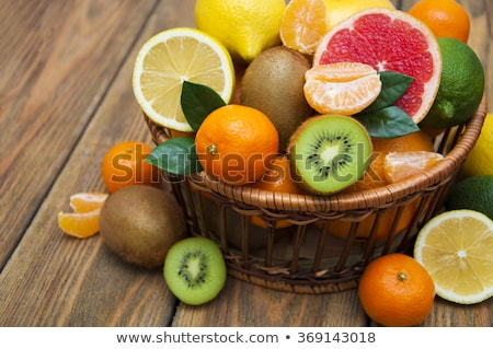 Red tangerines on the wooden background Stock photo © Alex9500