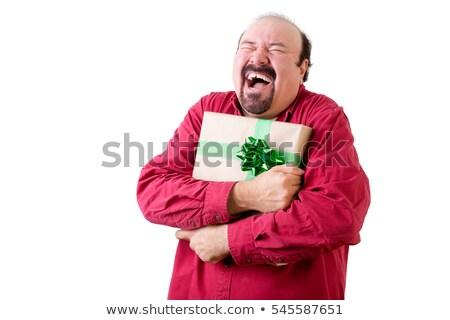 Joyful balding man holding present to chest Stock photo © ozgur