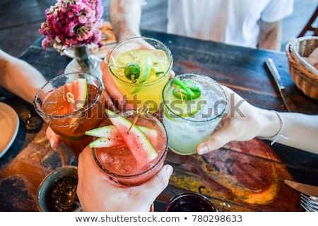 Young woman drinking cocktail Stock photo © deandrobot