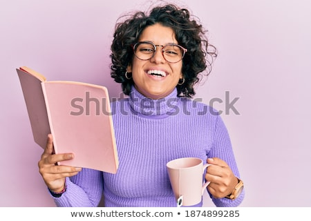 Portrait of a curly young girl reading book out loud Stock photo © deandrobot