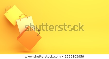 yellow shopping bag stock photo © devon