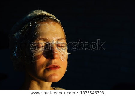 Skin care women concept. Facial mask and beauty treatment proced Stock photo © NikoDzhi