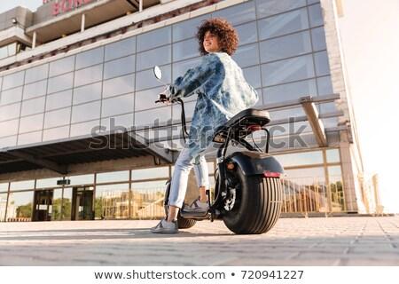 молодые · улыбающаяся · женщина · сидят · современных · мотоцикле · улице - Сток-фото © deandrobot