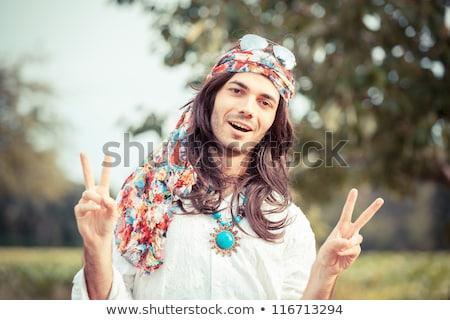 young caucasian happy hippie man gesturing stock photo © rastudio