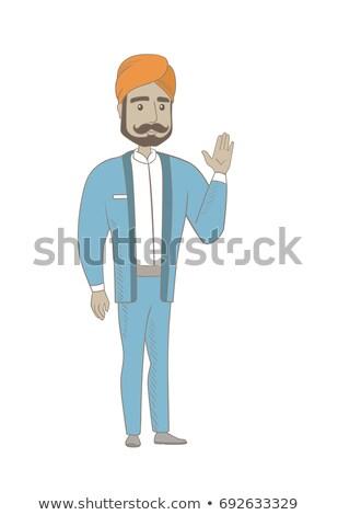 Young hindu businessman waving his hand. Stock photo © RAStudio