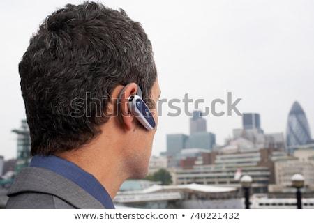 Homem bluetooth fone fora cidade tecnologia Foto stock © IS2