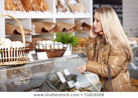 woman pointing at bread on shelf stock photo © is2