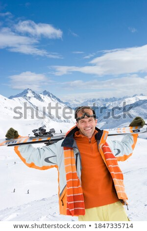 man looking over snow covered peak stock photo © is2