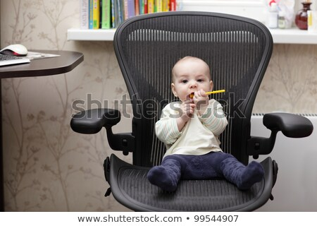 Stockfoto: Portrait Of A Baby In An Office Chair