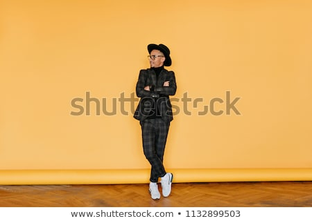 full length photo of smiling fashionable african guy standing wi stock photo © deandrobot