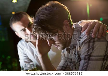 Lehangolt férfi fej lefelé bár pult Stock fotó © wavebreak_media