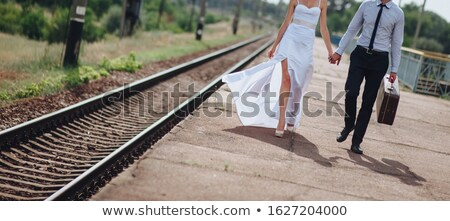 Newlyweds on country road with suitcase Stock photo © IS2