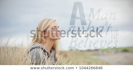 side view of beautiful blonde woman sitting with eyes closed Stock photo © feedough