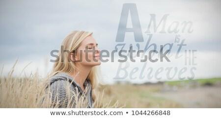 Oldalnézet gyönyörű szőke nő ül csukott szemmel faszék Stock fotó © feedough