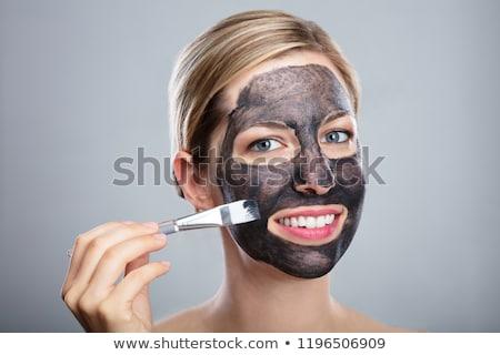 Vrouw houtskool gezicht masker borstel Stockfoto © AndreyPopov