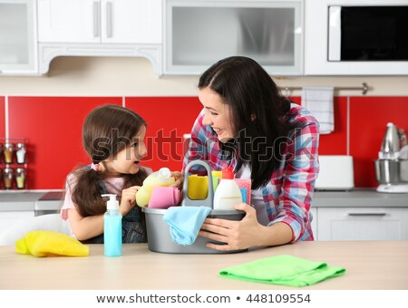 Daughter and mother cleaning kitchen table  Stock photo © dashapetrenko