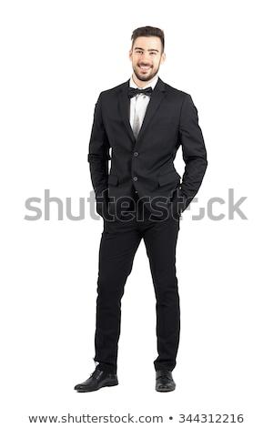 Glimlachend elegante man smoking permanente handen Stockfoto © feedough