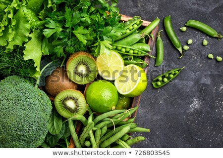 healthy variety of green vegetables cabbage spinach asparagus pieces of cucumber and pepper on a g stock photo © artjazz