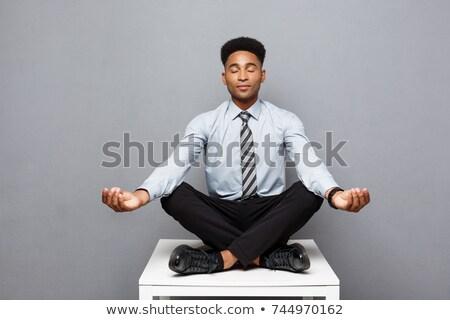 Zakenman meditatie jonge kantoor hand Stockfoto © AndreyPopov
