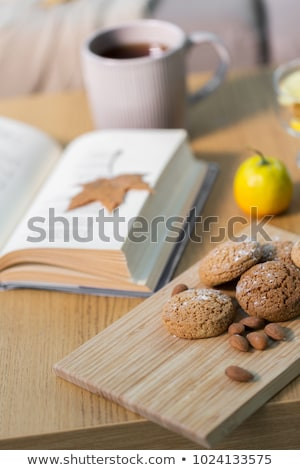Stock photo: book, lemon, tea and cookies on table at home