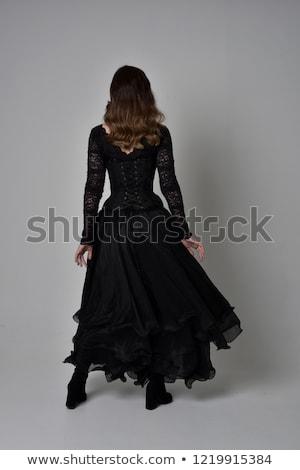 Kadın uzun siyah elbise poz gri yalıtılmış Stok fotoğraf © studiolucky