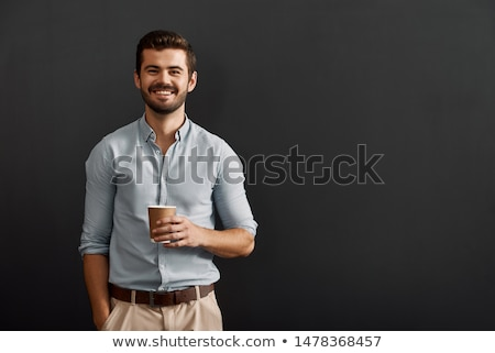 Portrait of a cheerful young bearded man standing Stock photo © deandrobot
