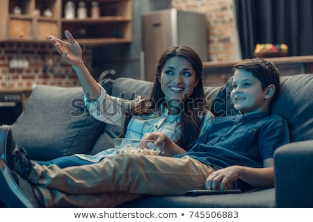 adorable child Watching TV in his home with popcorn Stockfoto © Lopolo