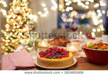 cake and other food on christmas table at home Stock photo © dolgachov