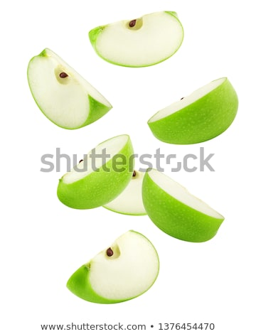 A group of green apples levitating on a white background Stock photo © butenkow