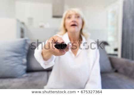 成熟した 魅力のある女性 リモコン テレビ 家 ホーム ストックフォト © Lopolo