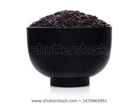 black bowl of raw organic black venus rice on white background healthy food stock photo © denismart