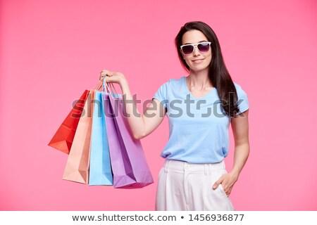 Young stylish shopaholic in sunglasses and casualwear Stock photo © pressmaster