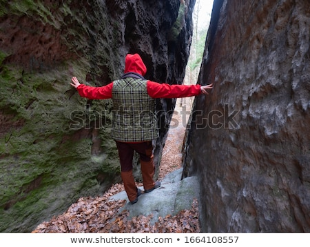 Woman standing in sandstone cave and tunnel  Stock photo © lovleah