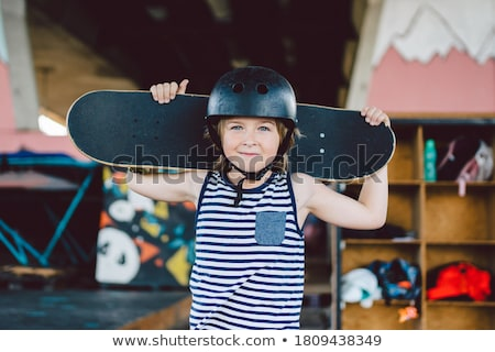Skateboarder in Protective Helmet Riding Outdoors Stock photo © robuart