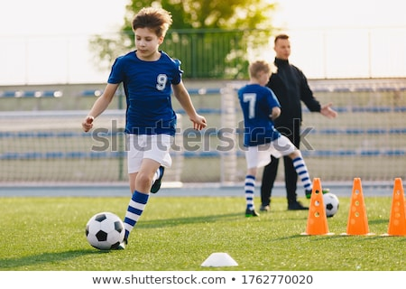Kids Sports: Teaching Children to Improve Soccer Skills. Football camp for kids Stock photo © matimix