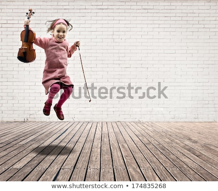 Stock photo: Little Girl On The Floor With A Violin