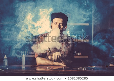 Hipster Holding Vape Electronic Cigarette Tattoo Stock photo © patrimonio