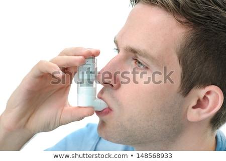 Jeune homme asthme prévention médicaux bouche blanche Photo stock © Lopolo