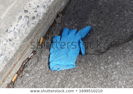 used latex glove thrown on the street Stock photo © nito