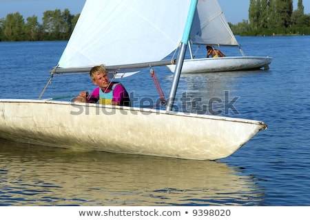 Two teenagers in sail boat Stock photo © photography33