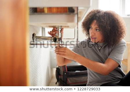 Fiatal vízvezetékszerelő dolgozik víz kék munkás Stock fotó © photography33