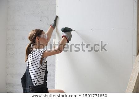 Kobieta wiercenia strony kobiet niebieski narzędzia Zdjęcia stock © photography33