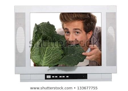 Homem alimentação repolho dentro televisão cara Foto stock © photography33
