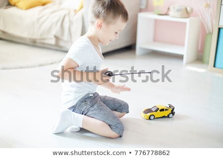 Stok fotoğraf: Little Boy With A Remote Controlled Car