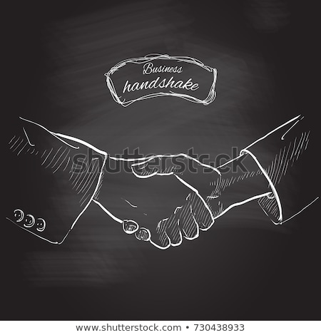 Chalk drawing of handshaking on a blackboard stock photo © bbbar