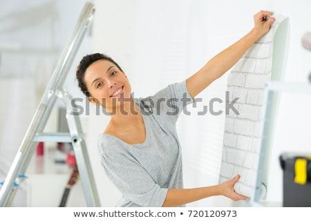 Stock fotó: Woman With Rolls Of Wallpaper