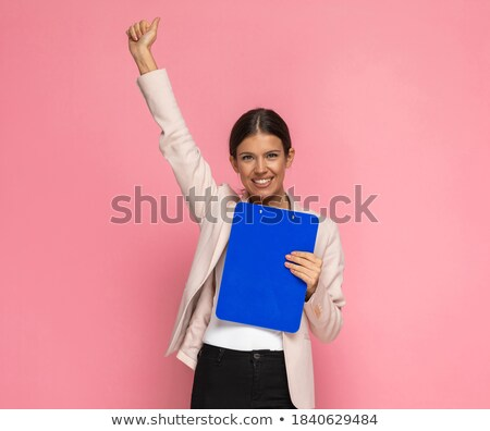 good-looking businesswoman holding clipboard Stock photo © photography33