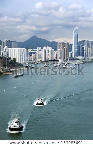 hong kong apartment blocks and fishing boats at coast stock photo © kawing921
