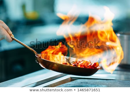 Chef holding a sauteing pan Stock photo © photography33