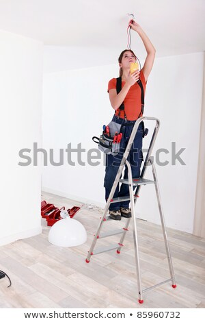handywoman fixate a lamp on the ceiling stock photo © photography33